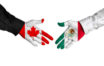 Canada and Mexico leaders shaking hands on a deal agreement